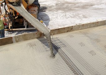 Ready mix concrete pouring from a cement mixer